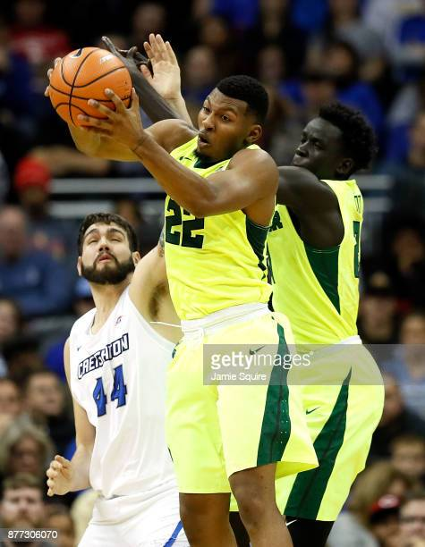 King McClure of the Baylor Bears grabs a rebound over Manny Suarez of the Creighton Bluejays during the National Collegiate Basketball Hall Of Fame...