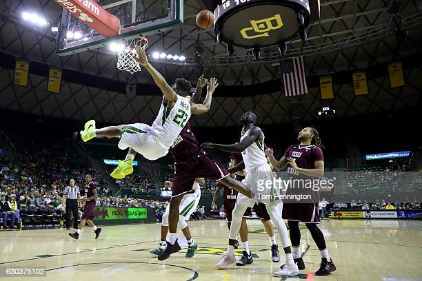 King McClure of the Baylor Bears is fouled by Derrick Griffin of the Texas Southern Tigers in the first half at Ferrell Center on December 21, 2016...