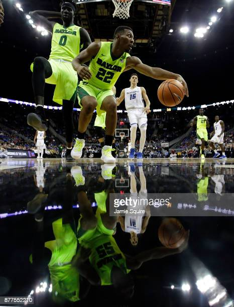 King McClure of the Baylor Bears lunges for the ball during the National Collegiate Basketball Hall Of Fame Classic Championship game against the...