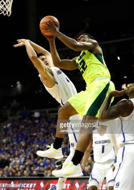 King McClure of the Baylor Bears shoots as Martin Krampelj of the Creighton Bluejays defends during the National Collegiate Basketball Hall Of Fame...