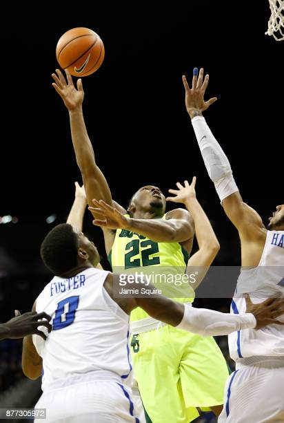 King McClure of the Baylor Bears shoots during the National Collegiate Basketball Hall Of Fame Classic Championship game against the Creighton...