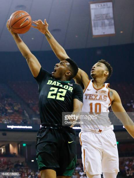 King McClure of the Baylor Bears shoots the ball against Eric Davis Jr #10 of the Texas Longhorns at the Frank Erwin Center on March 4 2017 in Austin...