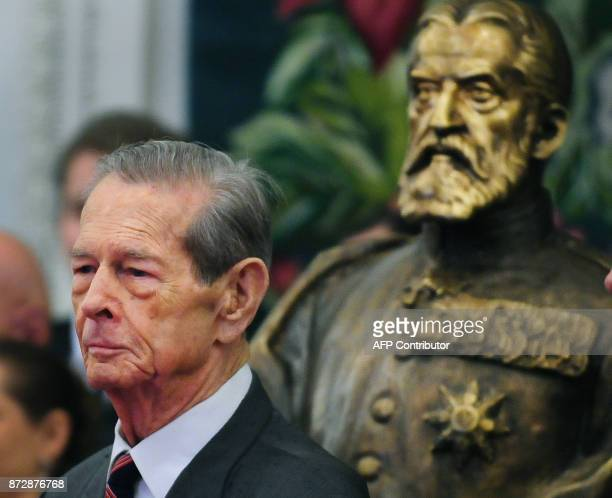 King Michael I of Romania is pictured next to a bronze sculpture of King Carol I after his anniversary speech at the Romanian Parliament in Bucharest...