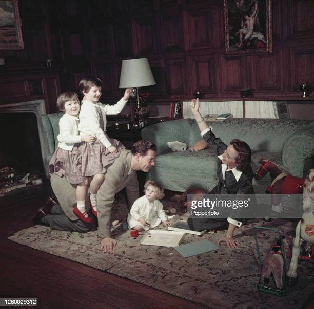 King Michael I of Romania the last King of Romania and his wife Queen Anne of Romania play with their children Princess Margareta Princess Elena and...