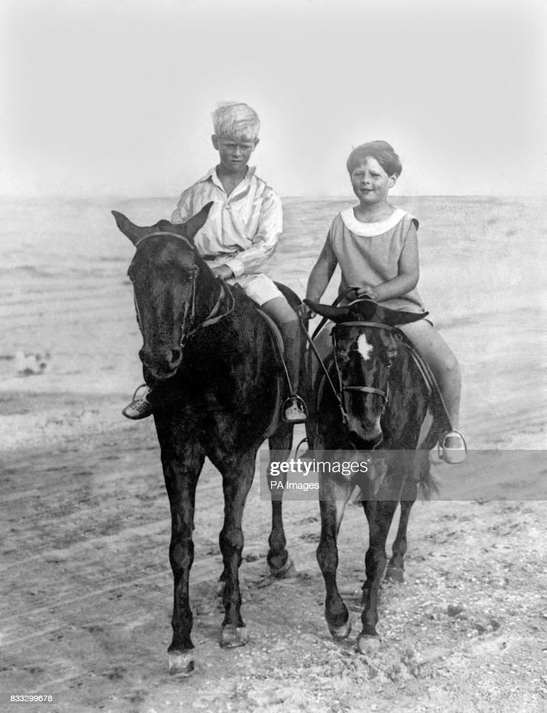 King Michael Of Romania (right) rides with his cousin Prince Philip of Greece on the sands at Constanza.