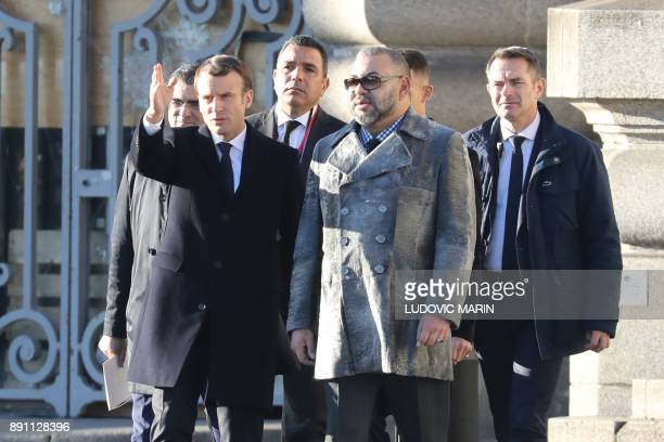 King Mohammed VI of Morocco and French President Emmanuel Macron arrive arrive on the Mirage boat during the One Planet Summit on December 12 at La...