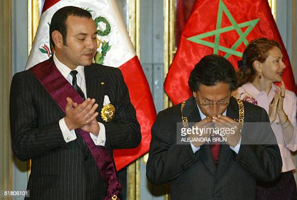 King Mohammed VI of Morocco and Peru's first lady Eliane Karp applaud as Peruvian President Alejandro Toledo kisses the decoration received from the...
