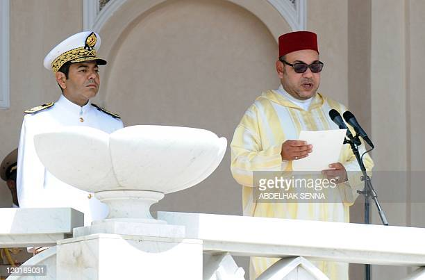 King Mohammed VI of Morocco delivers a speech as his brother Prince Moulay Rachid listens during a ceremony to mark the anniversary of his 1999...
