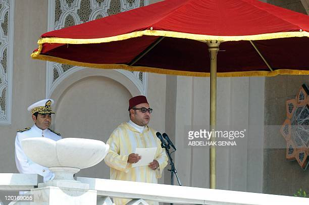 King Mohammed VI of Morocco delivers a speech as his brother Prince Moulay Rachid listen during a ceremony to mark the anniversary of his 1999...