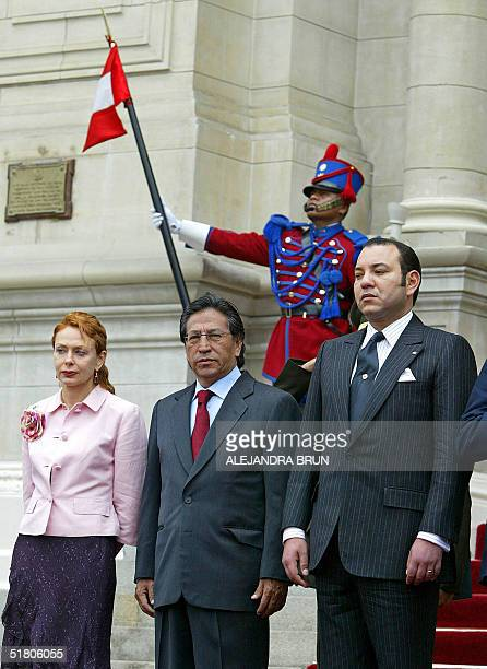 King Mohammed VI of Morocco Peruvian President Alejandro Toledo and his wife Eliane Karp listen to their respective national anthems at the...