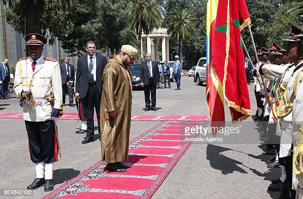 King Mohammed VI of Morocco reviews an honour guard during an official welcoming ceremony at National Palace in Addis Ababa Ethiopia on November 19...