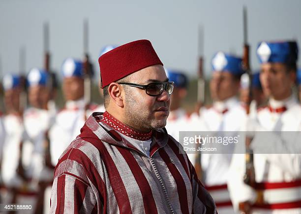 King Mohammed VI of Morocco walks down the red carpet at Rabat Airport on July 16 2014 in Rabat Morocco The new King and Queen of Spain are on a two...