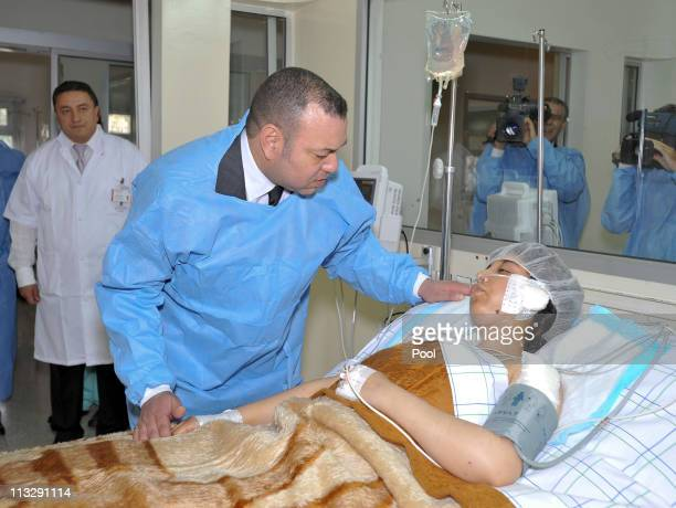 King Mohammed VI visits an injured woman at the Ibn Tofail Hospital on April 30 2011 in Marrakech Morocco A remotecontrolled nail bomb exploded and...