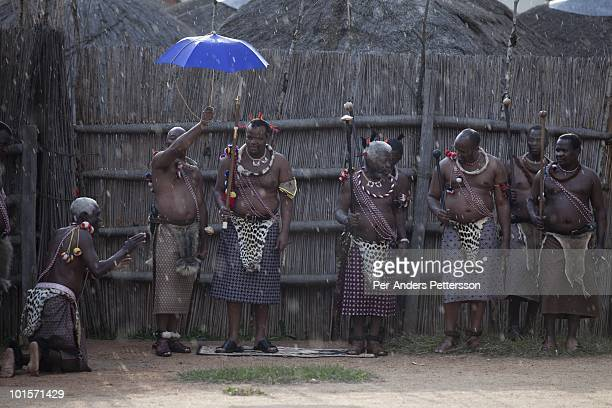 King Mswati III and members of the royal family watch a traditional Reed dance ceremony at the stadium at the Royal Palace on August 30 in Ludzidzini...