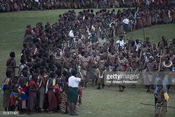 King Mswati III dances in front of young virgins at a traditional Reed dance ceremony at the stadium at the Royal Palace on August 31 in Ludzidzini...