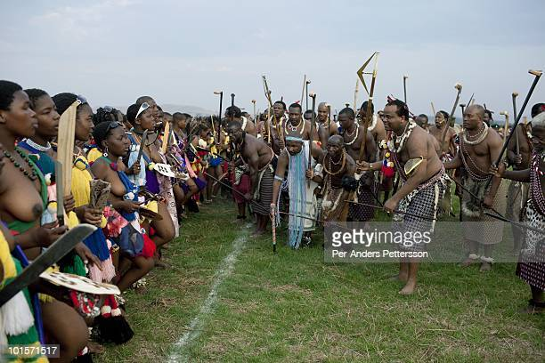 King Mswati III dances in front of young virgins at a traditional Reed dance ceremony at the stadium at the Royal Palace on August 30 in Ludzidzini...