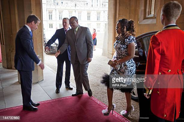 King Mswati III of Swaziland and Inkhosikati LaMbikiza arrive at a lunch For Sovereign Monarchs in honour of Queen Elizabeth II's Diamond Jubilee at...