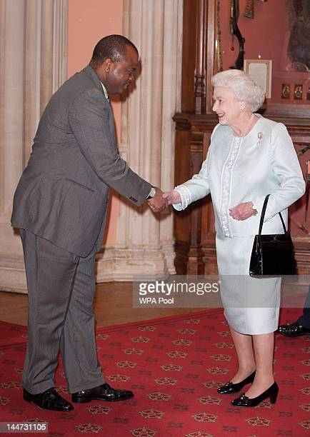 King Mswati III of Swaziland is greeted by Queen Elizabeth II at a lunch For Sovereign Monarchs in honour of Queen Elizabeth II's Diamond Jubilee at...