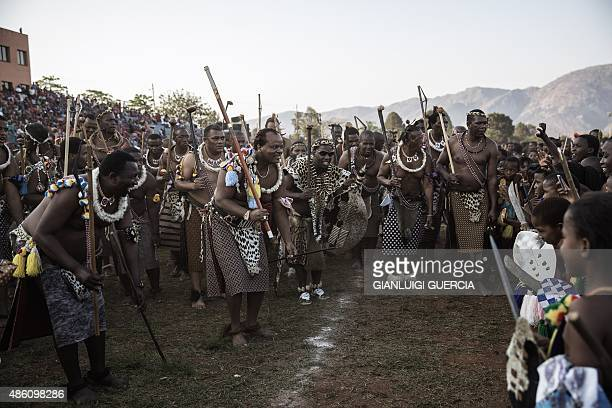 King Mswati III of Swaziland kneels down in a traditional show of appreciation of maidens as they sing and dance on the last day of the annual royal...