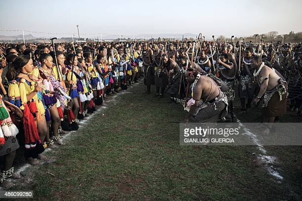 King Mswati III of Swaziland kneels down in atraditional show of appreciation for the maidens as they sing and dance on the last day of the annual...
