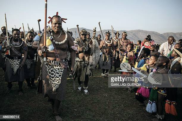 King Mswati III of Swaziland walks in a traditional show of appreciation for maidens as they sing and dance on the last day of the annual royal Reed...