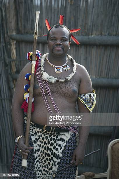 King Mswati III watch young virgins at a traditional Reed dance ceremony at the stadium at the Royal Palace on August 30 in Ludzidzini Swaziland...