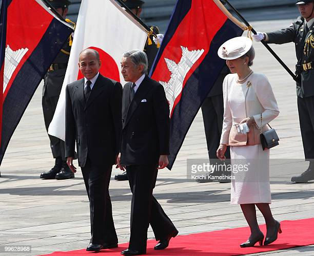 King Norodom Sihamoni of Cambodia is escorted by Japanese Emperor Akihito and Empress Michiko during his welcoming ceremony at the Imperial Palace on...