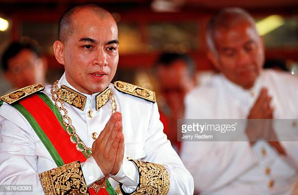King Norodom Sihamoni prays to his ancestors at a ceremony inside the Silver Pagoda of the Royal Palace The floor of the pagoda is covered with solid...