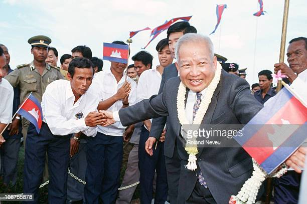 King Norodom Sihanouk greets his people before the start of Recoronation day celebration