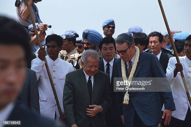 King Norodom Sihanouk greets UN Secretary General, Boutros Boutros-Ghali on his arrival at Pochentong Airport. The secretary general came to meet...