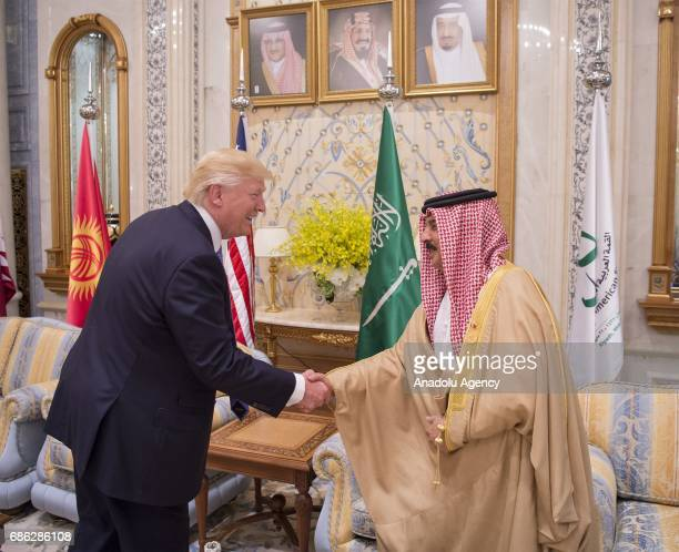 King of Bahrain Hamad bin Isa Al Khalifa and US President Donald Trump shake hands during the US Gulf Summit at Saudi Arabia's King Abdul Aziz...