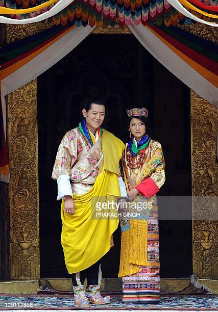 King of Bhutan Jigme Khesar Namgyel Wangchuck and newly crowned Queen of Bhutan Jetsun Pema pose for the media after their marriage ceremony at the...