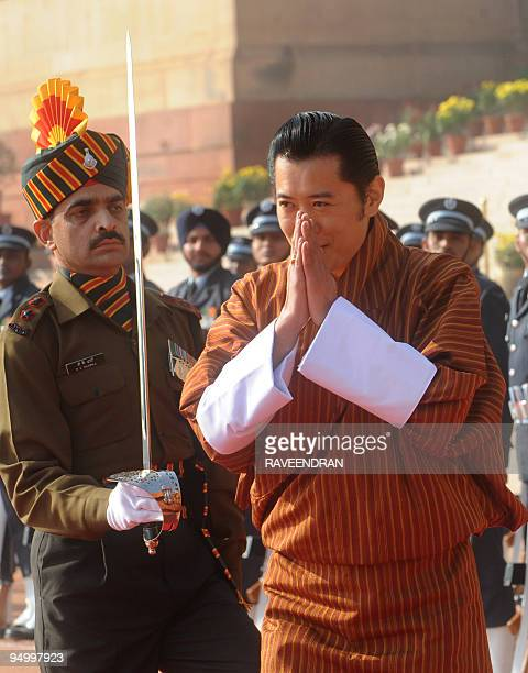 King of Bhutan, Jigme Khesar Namgyel Wangchuck greets Indian army soldiers during a welcome ceremony at the Presidential Palace in New Delhi on...