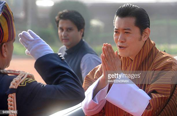 King of Bhutan Jigme Khesar Namgyel Wangchuck greets Indian army soldiers during a welcome ceremony at the Presidential Palace in New Delhi on...
