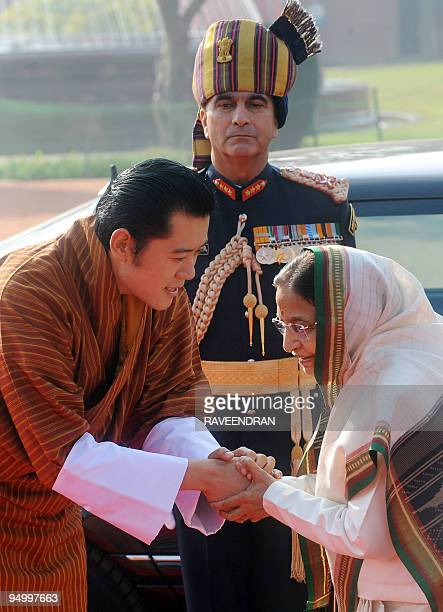 King of Bhutan Jigme Khesar Namgyel Wangchuck greets Indian President Prathiba Singh Patil during a welcome ceremony at the Presidential Palace in...