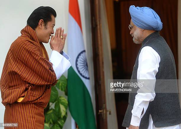 King of Bhutan Jigme Khesar Namgyel Wangchuck greets Indian Prime Minister Manmohan Singh at a meeting in New Delhi on December 22 2009 Wangchuck is...