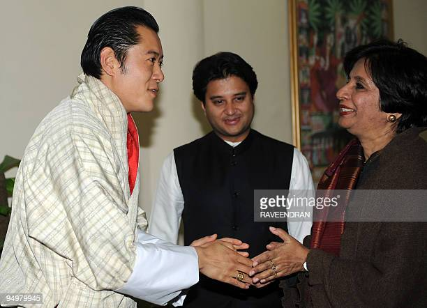King of Bhutan Jigme Khesar Namgyel Wangchuck is greeted by Indian Foreign Secretary Nirupama Rao as Minister of State for Commerce and Industry...