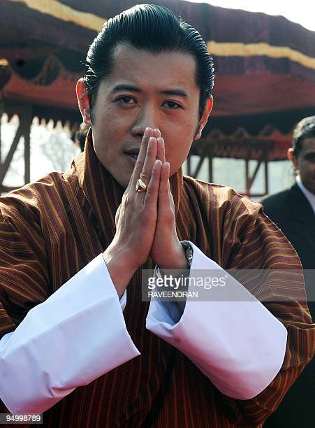 King of Bhutan Jigme Khesar Namgyel Wangchuck makes a traditional greeting on his arrival at the Presidential Palace in New Delhi on December 22 2009...