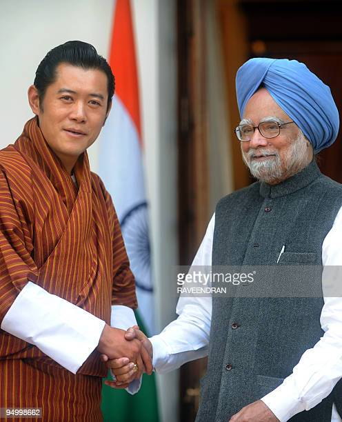 King of Bhutan Jigme Khesar Namgyel Wangchuck shakes hands with Indian Prime Minister Manmohan Singh during a meeting in New Delhi on December 22...