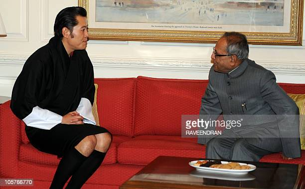 King of Bhutan Jigme Khesar Namgyel Wangchuck talks with Indian Finance Minister Pranab Mukherjee during a meeting in New Delhi on October 20 2010...