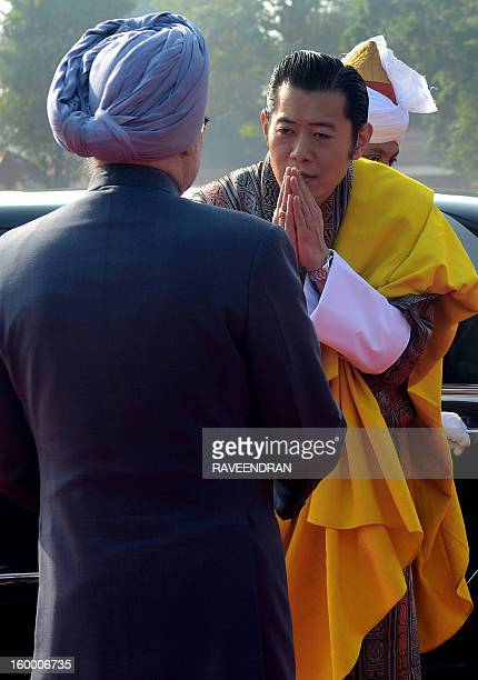 King of Bhutan Jigme Khesar Namgyel Wangchuk greets Indian Prime Minister Manmohan Singh during the welcome ceremony at the Presidential Palace in...