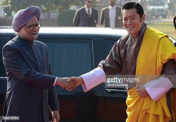 King of Bhutan Jigme Khesar Namgyel Wangchuk shakes hands with Indian prime minister Manmohan Singh during the welcome ceremony at the Presidential...