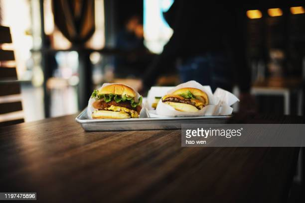 king of burger - burger king stock pictures, royalty-free photos & images