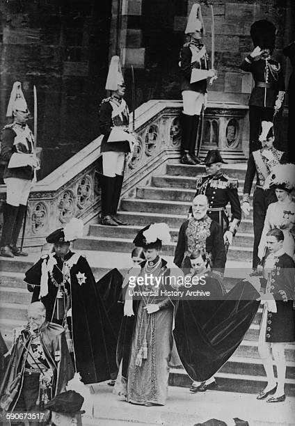 King of England George V and his wife Mary of Teck leaving the St George's Chapel at Windsor Castle after the Prince of Wales was invested with the...