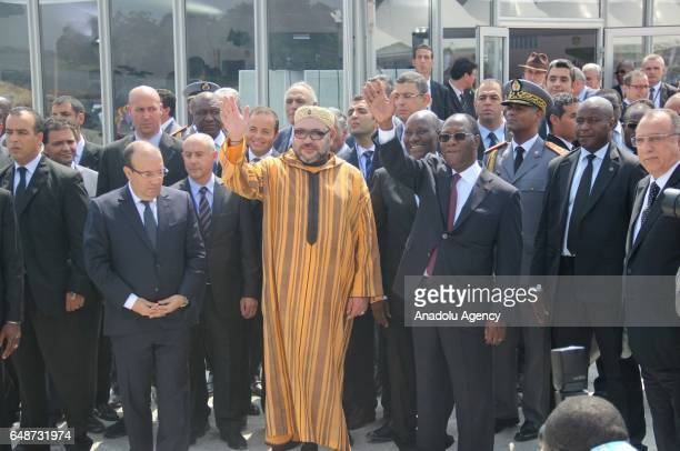 King of Morocco Mohammed VI and the President of the Ivory Coast Alassane Ouattara greet the people in Abidjan Ivory Coast on March 6 2017