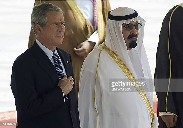 King of Saudi Arabia Abdullah bin Abdulaziz and US President George W Bush listen to the US national anthem during the latter's arrival ceremony at...