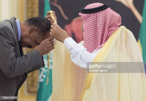 King of Saudi Arabia Salman bin Abdulaziz Al Saud presents the Order of King Abdulaziz to President of Eritrea Isaias Afwerki following a signing...
