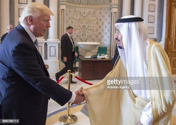 King of Saudi Arabia Salman bin Abdulaziz Al Saud shakes hands with US President Donald Trump duirng the US Gulf Summit at King Abdul Aziz...