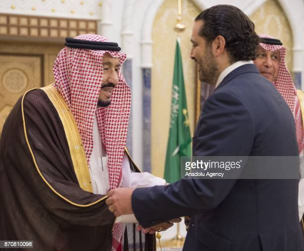 King of Saudi Arabia Salman bin Abdulaziz Al Saud shakes hands with Former Prime Minister of Lebanon Saad Hariri who resigned recently at Palace of...