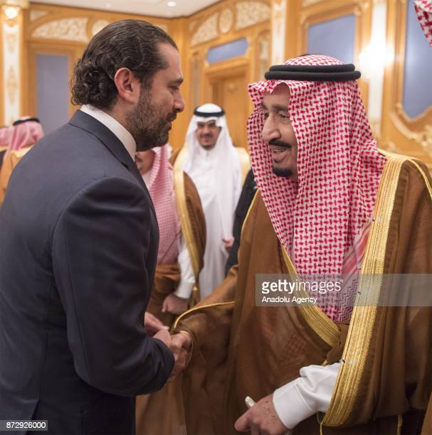 King of Saudi Arabia Salman bin Abdulaziz Al Saud shakes hands with Former Prime Minister of Lebanon Saad Hariri who resigned recently at King Salman...